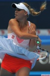 Caroline Wozniacki of Denmark plays a stroke during her women's singl
